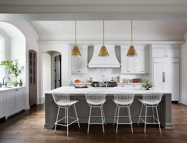 Kitchen. White and gray kitchen cabinet Ideas. White Kitchen with gray kitchen island. Lighting above island are the Thomas O'Brien's Goodman Hanging Lamp #Kitchen Ryan Street & Associates