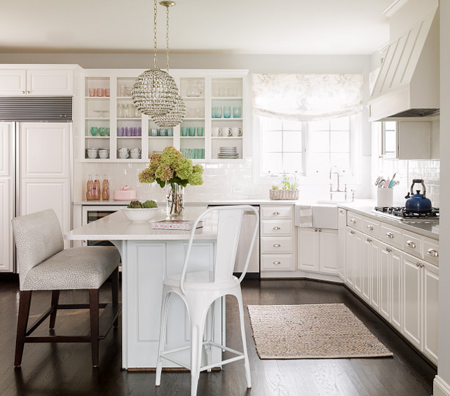 L shaped kitchen with island. White L shaped kitchen with island. Island Pendant Lighting is a pair of Currey & Co Roundabout Pendants. #Lshapedkitchen #WhiteLshapedkitchen