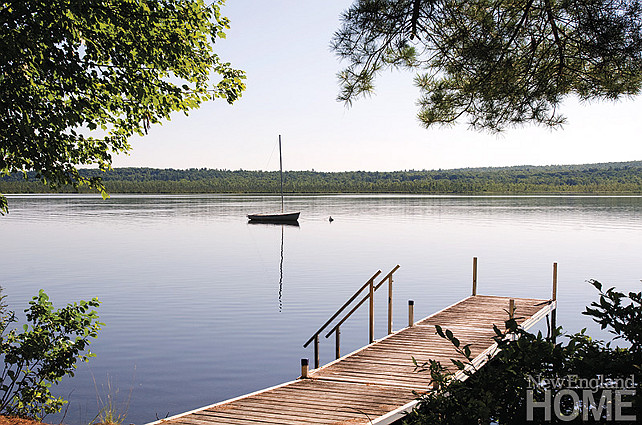 Lake. Lake house with dock and boat. Boating, swimming and docks to leap off make this the perfect spot for family fun. #Lake #LakeHouse #Dock #Boat New England Home Magazine.