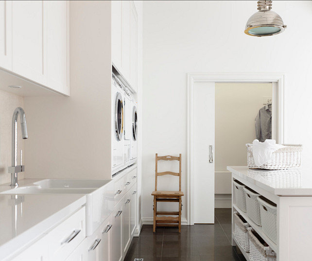 Laundry Room. Bright Laundry room with custom cabinets, white quartz countertop and laundry room island. #LaundryRoom #LaundryRoomIdeas #laundryRoomCabinet #LaundryRooIsland #LaundryRoomStorageIdeas