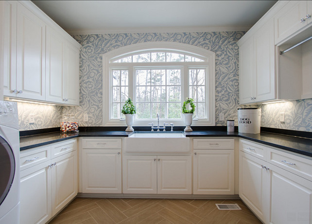 Laundry Room. Laundry Room Design Ideas. Spacious laundry room with custom cabinets, wallpaper, honed granited countertop and farmhouse sink. #LaundryRoom #LaundryRoomDesign #LaundryRoomIdeas