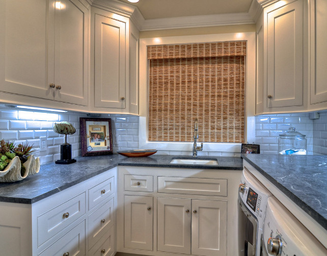Laundry Room. Laundry Room Design. Built in cabinets and marble counter tops make this laundry room organized as well as beautiful. Countertop is soapstone. #LaundryRoom #LaudnryRoomDesign #LaundryRoomIdeas #LaundryRoomCabinets