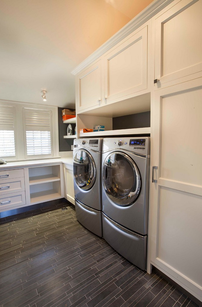 Laundry Room. Laundry Room with durable flooring and deep custom cabinets. #LaundryRoom John Johnstone.