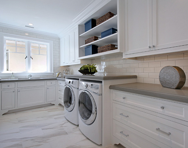 Laundry Room. Laundry room with white shaker cabinets, marble tile floors, grey quartz countertop, shelving and subway tile backsplash with grey grout. #Laundryroom