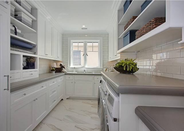 Laundry Room. White laundry Room cabinet. White laundry Room cabinet with gray quartz countertop and white subway tile backsplash. #laundryRoom