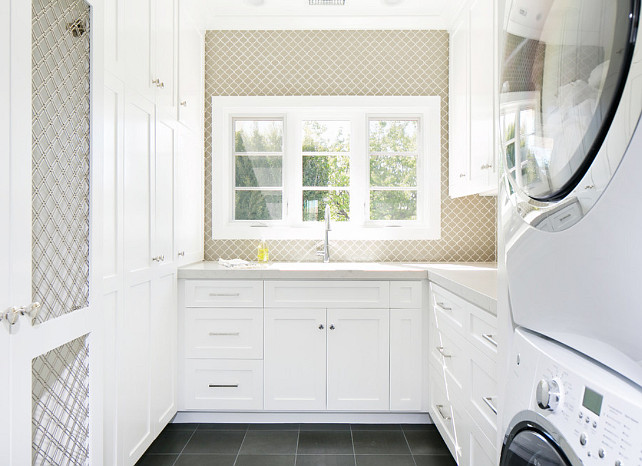 Laundry room. Neutral Laundry room with bluestone floor tiles. Laundry room with white cabinets. Laundry room with wallpaper. Floor to ceiling Laundry room cabinet. #Laundryroom Brooke Wagner Design.
