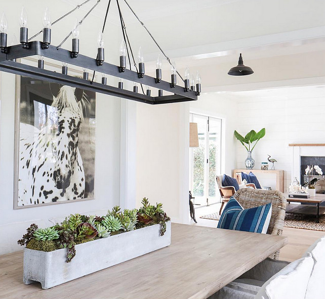 Linear Chandelier Dining Room. Dining room with Linear Chandelier, black and white horse picture and white walls. #DiningRoom #LinearChandelier . Blackband Design.