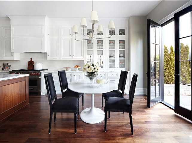 Breakfast Nook Design. This breakfast nook is modern and inviting. I am loving the table and lighting. #BreakfastNook #BreakfastArea #EatingNook