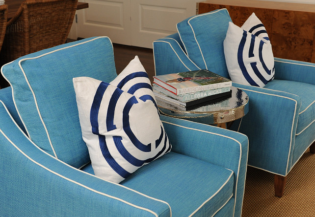 Living Room Chair and Pillow Ideas. Coastal Living room chair and pillow ideas. This coastal living room also features blue armchairs with white piping and decorative pillows and a accordion side table. #LivingRoom #Coastal #Chair #Pillows