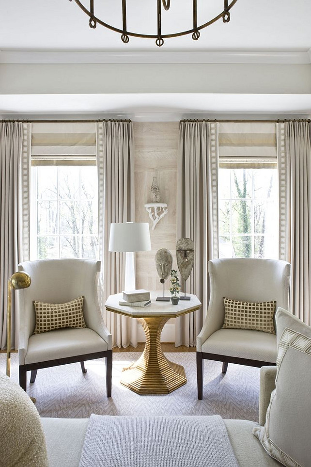Living Room Draperies and Roman Shades. Living room with horizontal stripe roman shade - roman shade mounted at height of rod. #LivingRoom #Draperies #RomanShades #WindowTreatment Via Michael Hampton Design.