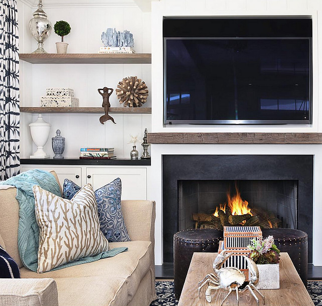 Living Room. Living Room Bookcase on both sides of fireplace. The bookshelves are made or reclaimed wood with backdrop made of shiplap. #livingroom #Bookcase #Bookshelves Blackband Design.