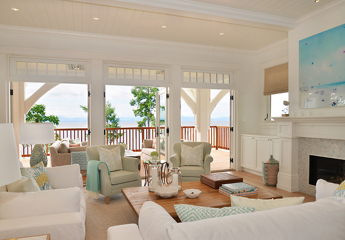 Living Room. Coastal living room, pillows, texture, light colors, white oak floors, and turquoise and seafoam decor. Sunshine Coast Home Design.