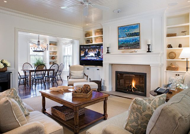 Benjamin Moore Dove Wing. Living room Fireplace. Living room fireplace with paneled mantel. Paneled mantel fireplace - living room. This cozy living room is painted in a warm white paint color: BM Dove Wing.  #PaneledMatel #Mantel #Fireplace #LivingRoom #BenjaminMooreDoveWing SLC Interiors.