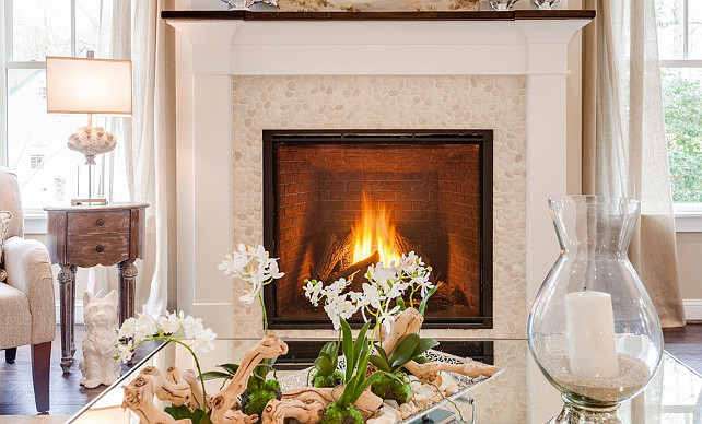 Living room fireplace with coastal decor. #Livingroom #Fireplace #Coastal