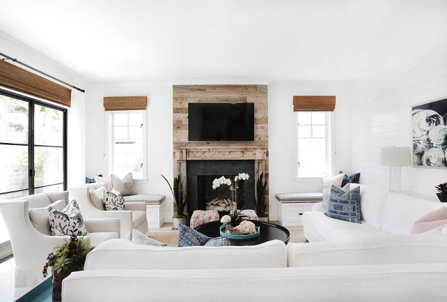 Living room with white sectional. Blackband Design.