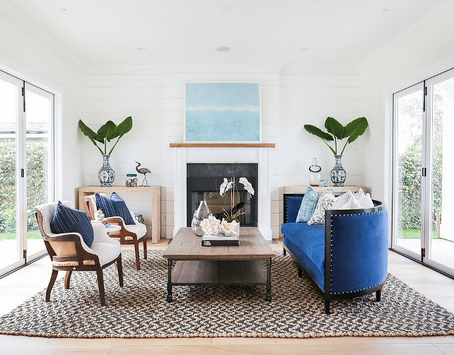 Living room. Transitional living room with blue and white decor, natural fibre rug, reclaimed wood coffee table and tongue and groove accent wall. #livingRoom Blackband Design.