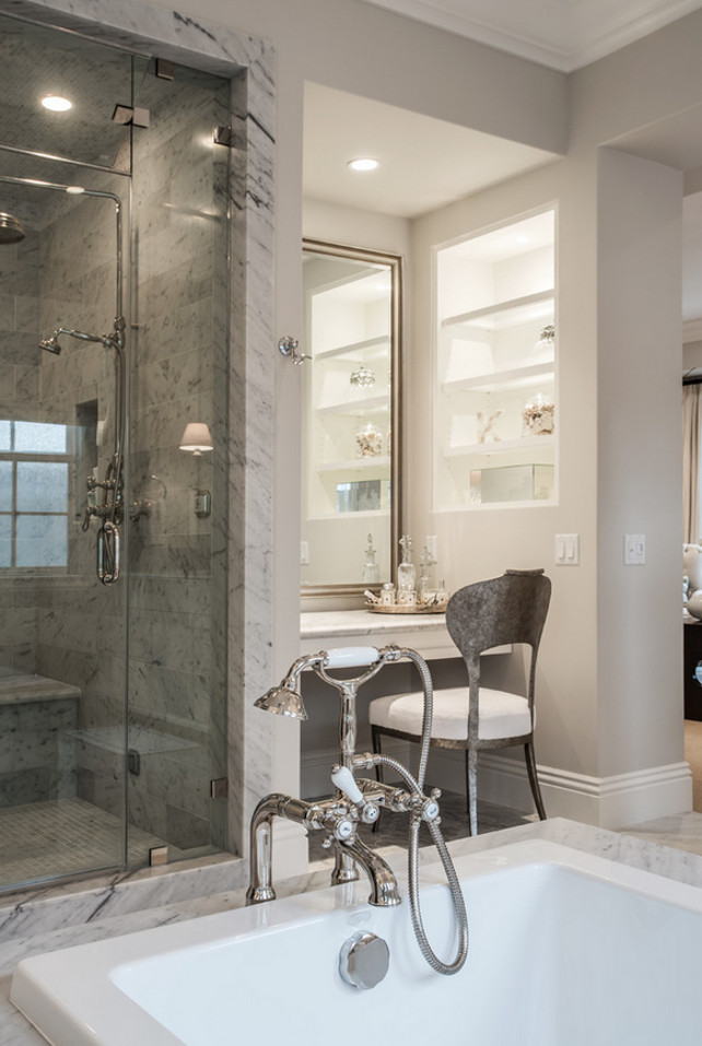 Master Bath Ideas. This master bathroom features a built-in vanity under silver leaf mirror, next to built-in niche filled with shelves beside a large glass shower. Legacy Custom Homes, Inc.