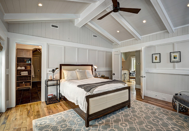 Master Bedroom Layout. Beadboard. Board and batten. Double doors. Hardwood floors. Master bedroom. Peaked ceiling. Tongue and groove. Vertical shiplap. White beams. White trim. Wood walls