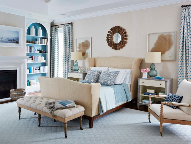 Master Bedroom. Coastal Inspired Bedroom with fireplace and neutral color scheme. The master bedroom is wallpapered in grass cloth by Phillip Jeffries. #Bedroom #MasterBedroom