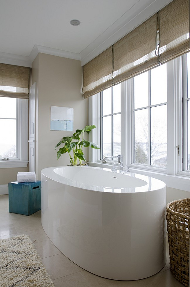 Modern Bath with oval freestanding bathtub. #Bathrtub #modernBathroom #Bathroom Kristina Crestin Design.