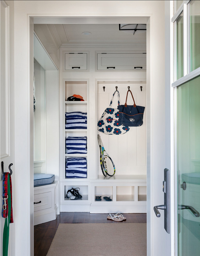 Mudroom Design. Great storage ideas are found in this mudroom. Paint Color is 50% China White, 50% Linen White by Benjamin Moore. #Mudroom #MudroomIdeas
