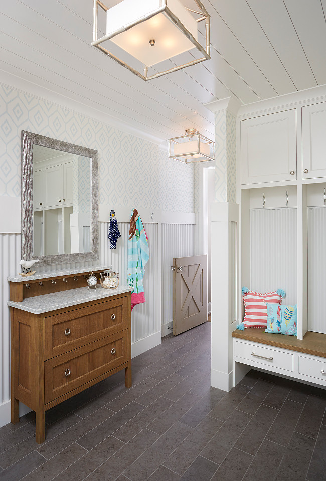 Mudroom. Durable mudroom ideas. Mudroom with corrugated steel in a white powder-coated finish as wainscoting. #Mudroom #Durable #Ideas Blend Interior Design.