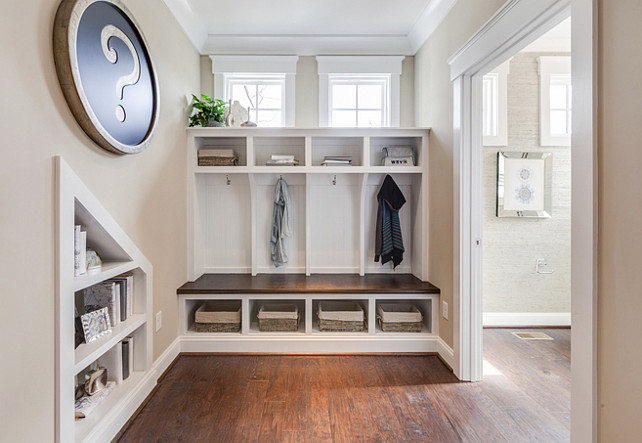 Mudroom. Mud Room. The spiffy mudroom, located just behind the staircase, features four built-in cubbies whose bench seating and dividers possess a distinctive and intentional church pew aesthetic. #Mudroom