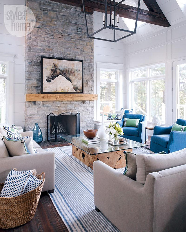 Muskoka Cottage Living Room. Living Room with tall stone fireplace. #Muskoka #Cottage #LivingRoom #Fireplace #StoneFireplace Bachly Construction via Style at Home.