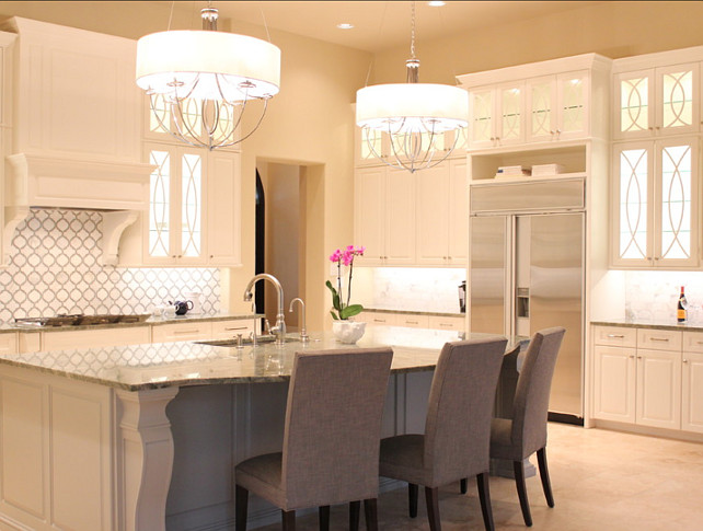 NR Interiors. Kitchen Lighting Ideas. These two chandeliers above the island are by ELK Lighting, model #101216 in polished nickel finish and are available with or without the drum shade. #KitchenLighting #KitchenIdeas