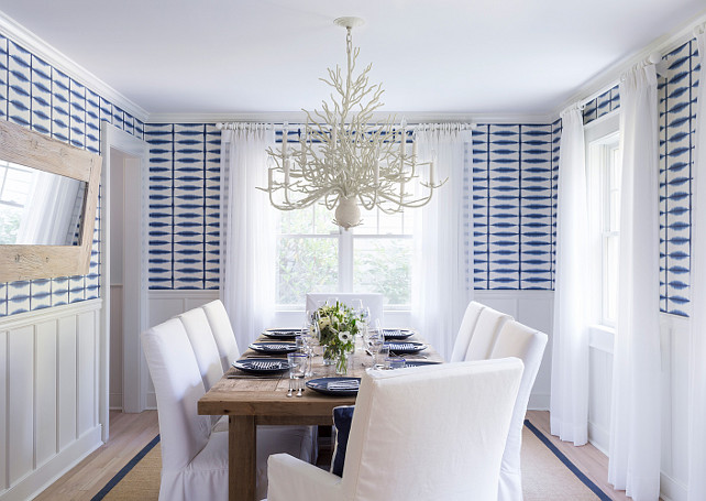Attractive Dining Room. Bleached Wood Floors, Sisal Rug, Slipcovered White Cotton  Chairs, Blue