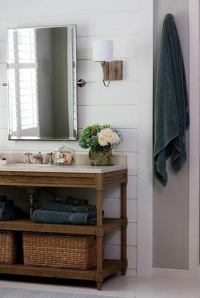 Open Bathroom Vanity with baskets. Bathroom with horizontal shiplap walls lined with a Restoration Hardware Weathered Oak Double Washstand with Italian Crema Marble Countertop placed under a rectangular pivot mirror illuminated by polished nickel and rustic wood sconces. Kristin Peake Interiors. #Bathroom #Vanity #Baskets