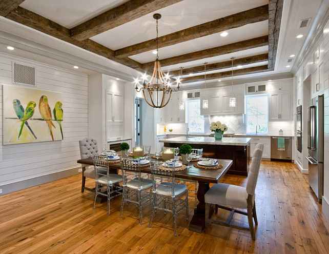 Open Floor Plan. Kitchen Open Floor Plan. Open Concept. Open Layout Kitchen. Clear chairs, Darker Trim, glass pendants, kitchen open plan, reclaimed beams, reclaimed oak, rope light, shiplap, tufted chairs, white cabinets, wood floors. Ink Architecture.
