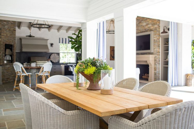 Outdoor dining room. Outdoor dining room with whicker chairs and farmhouse table. Kelly Nutt Design.