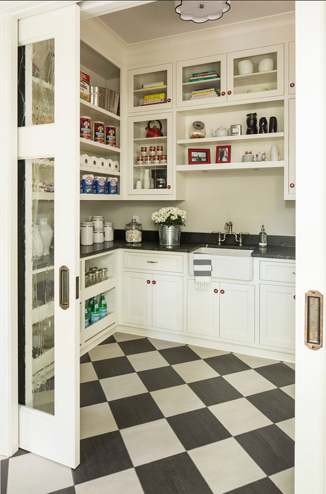"""Pantry Ideas. Great pantry design ideas. Kitchen pantry with lots of storage. Floors are """"Casalgrande Padana, and the name is Granitogres - Marta"""". The colors: """"Nero Acapulco"""" (darker) and """"Grigio Egeo"""" (lighter). Light fixture is the """"Robert Abbey Axis Aged Brass Ceiling Light"""" #Pantry #KitchenPantry #PantryIdeas"""