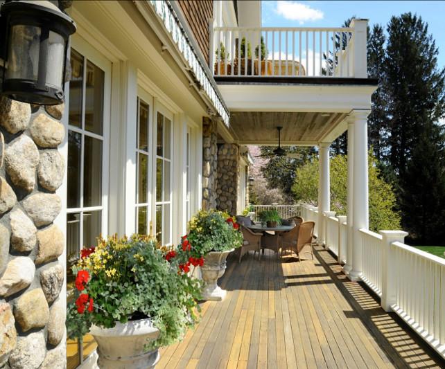 Patio Decor Ideas. Patio with classic patio furniture and patio decor. Planters, patio furniture. #Patio #PatioFurniture #PatioDecor Via Sotheby's Homes.