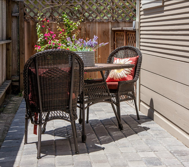 Patio Decorating Ideas. You really don't have to have a big patio to make it feel beautiful and inviting. Bring some flowers and comfortable patio furniture to make the best of your small patio! #Patio #PatioDecor #PatioIdeas