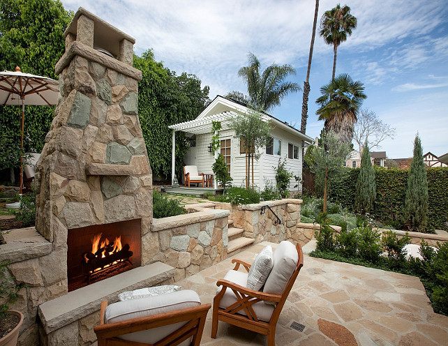 Patio Fireplace. Stone patio fireplace. Outdoor fireplace. Backyard fireplace. #Fireplace #Patio #Outdoor #Backyard Via Sotheby's Homes.