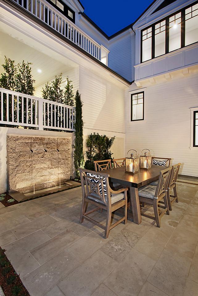 Patio with garden water features. Patio outdoor dining. #patio Spinnaker Development.