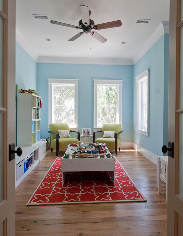 Playroom. Andersen windows. Blue Room Paint Color. Kids playroom. Red rug. Wood floors