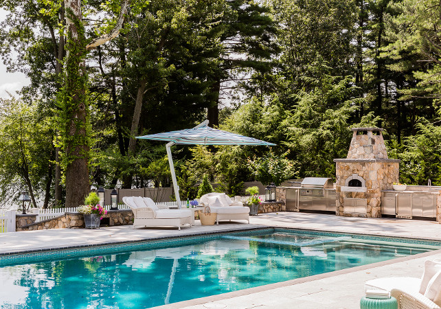 Backyard Designs With Pool And Outdoor Kitchen : Pool Area with outdoor kitchen The pool features an amazing outdoor