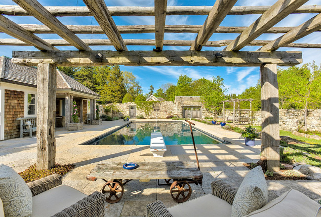 Pool Pergola. Backyard with pool, pool house and pergola. A pergola, made of reclaimed wood beams, offer a great view of the pool. #backyard #pergola #pool #poolhouse