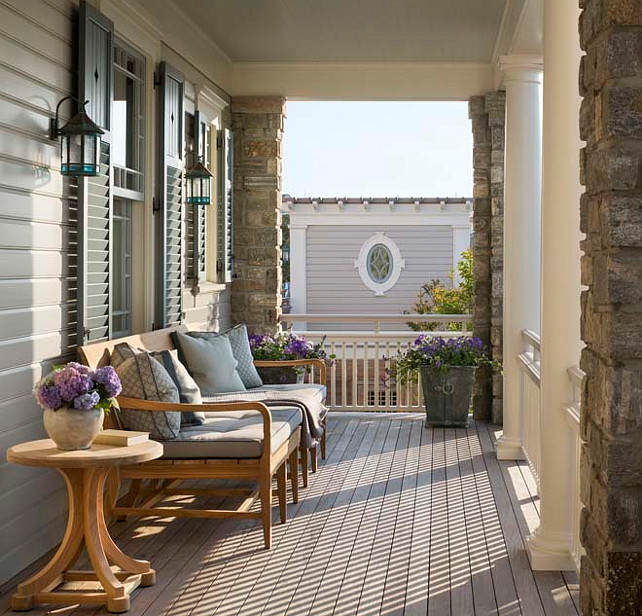 Top Front Porch Furniture Pin Porch Furniture. Porch. Front Porch. Front porch ceiling painted blue over windows dressed in gray shutters lined with an outdoor sofa facing stone piers and doric columns. #Porch #FrontPorch Robert A M Stern Architects