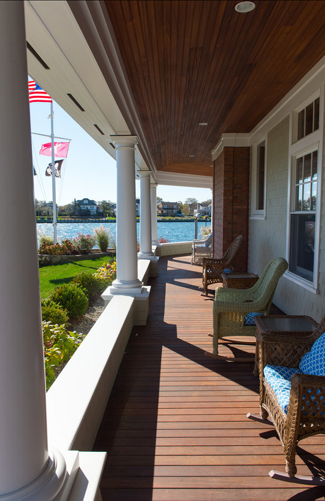 Porch. Porch Design Ideas. Porch with ocean view and wicker rocking chairs. #Porch #FrontPorch #PorchFurniture CMM Construction Inc.