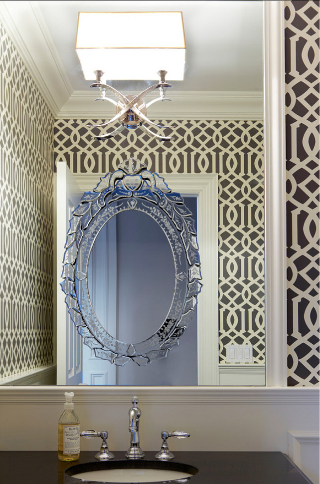Powder Room Design Ideas. Bold pattern charcoal and cream wallpaper was used to brighten up the walls above the paneling. Imperial Trellis in Parchment Midnight