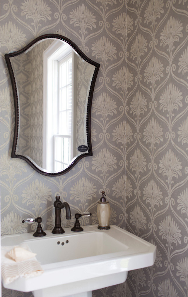 Powder room. Powder room with pedestal sink and gray wallpaper. #PowderRoom #pedestalSink ##GrayWallpaper Whitestone Builders.