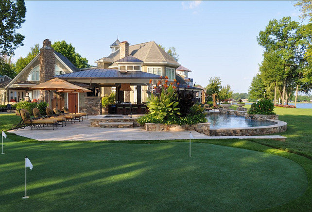 Putting Green. Backyard with putting green and pool. Bruce Clodfelter and Associates.