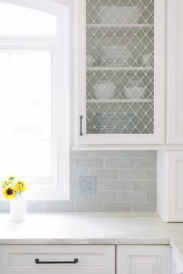 Quartzite Countertop. White Quartzite Countertop. Kitchen with White Quartzite Countertop and Blue Backsplash. #Quartzite #Countertop #WhiteQuartzite #Kitchen #BlueBacksplash   Kate Marker Interiors.