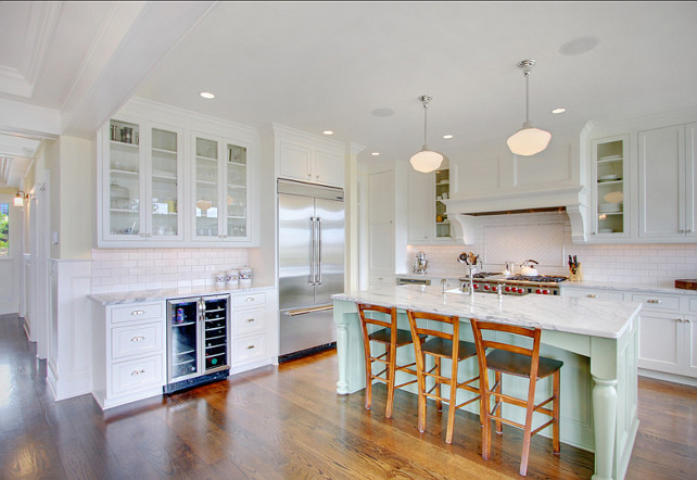 Kitchen with pale green island. Island Paint Color is Benjamin Moore Spring Sky 674. Beautiuful white kitchen with pale green island. #Kitchen #KitchenIsland #PaleGreen