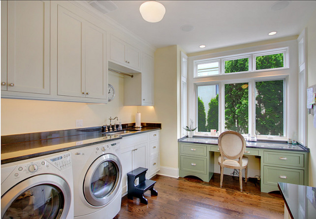 Laundry Room Design. The counter in this laundry room is slightly higher than typical but works well for laundry folding. #LaundryRoom #laundryRoomDesign