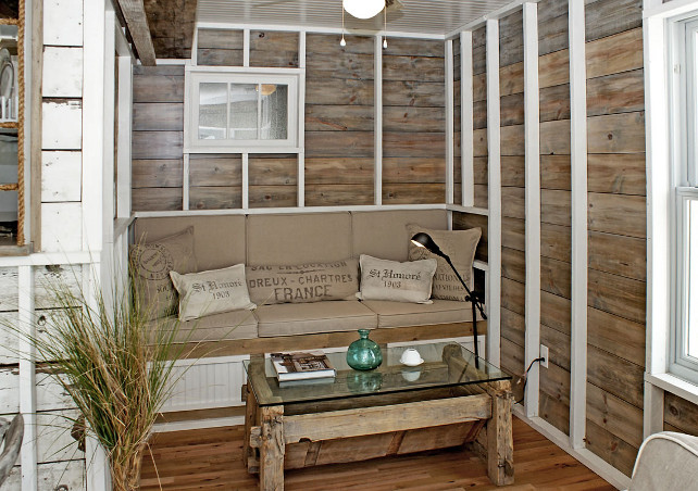 Reclaimed Wood Wall. Reclaimed Wood Wall Ideas. Coastal Reclaimed Wood Wall. Rough-hewn beams, 100-year old barn floors and reclaimed wood walls are features of this seating area as well as the dining and living areas that surround the kitchen that sits at the center of the ground floor. #ReclaimedWood #Wall